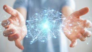 Hands open with rendered neurons in between
