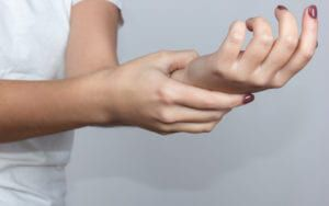 Woman Holding Numb Hand