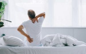 Man holding the neck and back pain