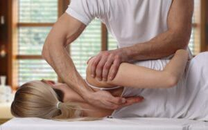 Woman undergoing a chiropractic adjustment